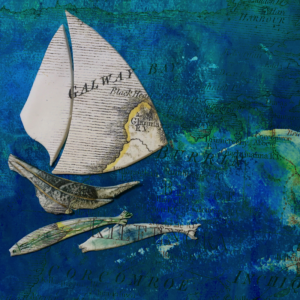 Ceramic boat and fish on paper sea